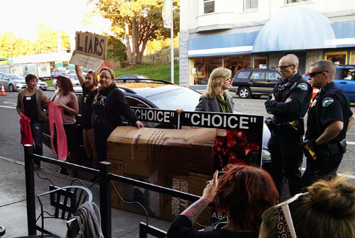 """Abortion advocates try to block our """"Choice"""" signs at a Planned Parenthood fundraiser in Bellingham, Washington on September 29th."""