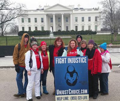 Chapter directors Lauren Handy (Wash, DC) and Melissa Stiwinter (Cullowhee, NC) rally with other pro-lifers before the White House in January for the March for Life.